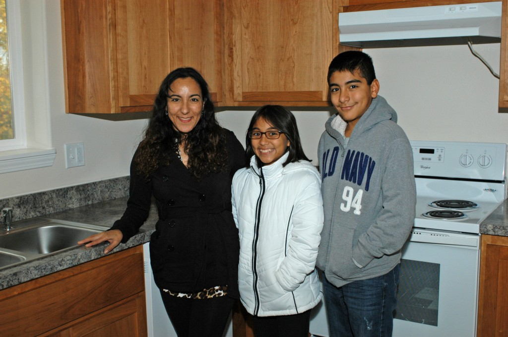 Ursula, Haley and Ishmael in their new kitchen.
