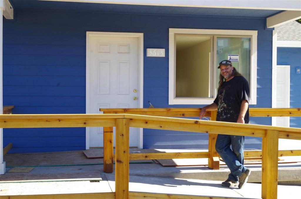 Albert shows off the front door of his home.
