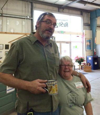 ReStore Director, Scott Morris, pals around with volunteer Nancy Keeton.